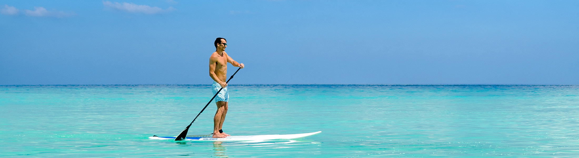Man paddle boarding at One&Only Reethi Rah