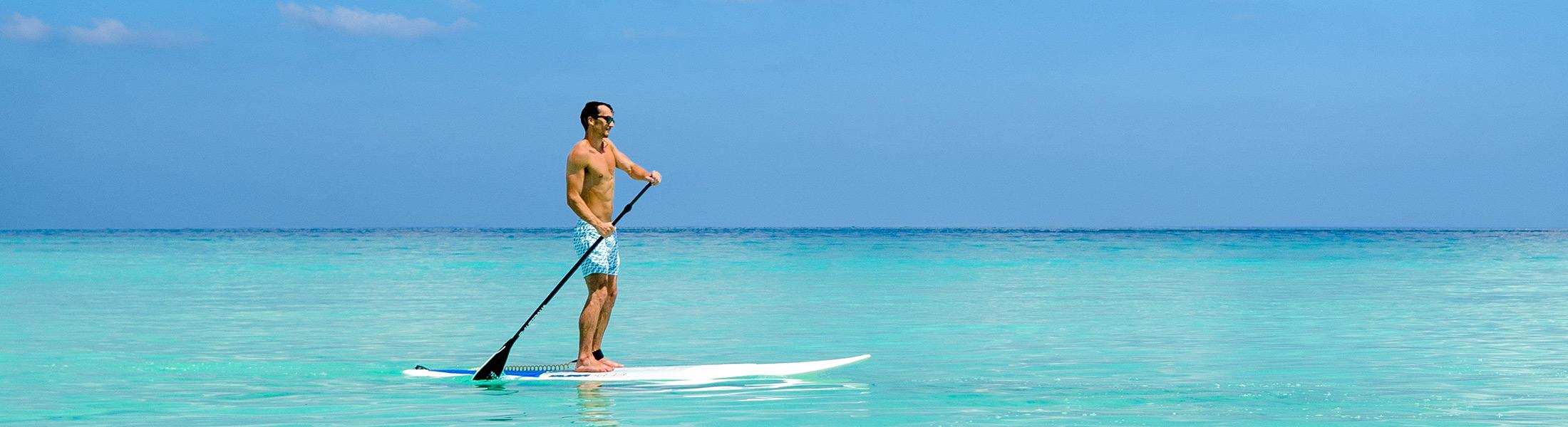 Man paddle boarding at One&Only Reethi Rah
