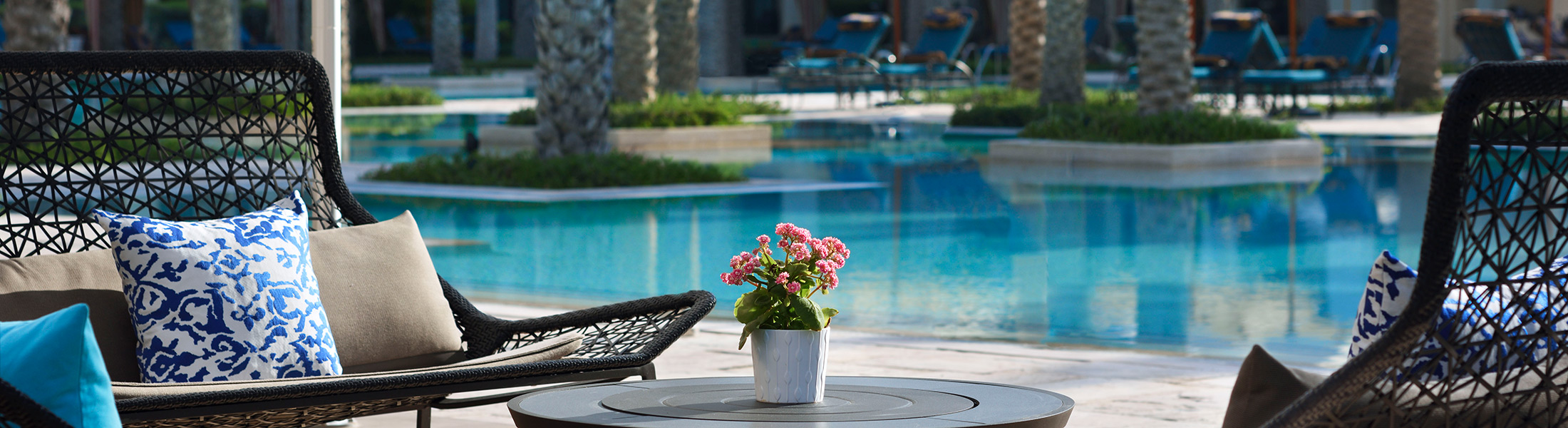 Poolside seating at One&Only Royal Mirage The Palace