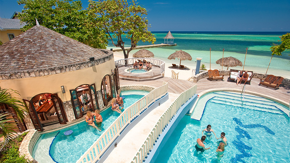 People swimming in the pool at Sandals Montego Bay
