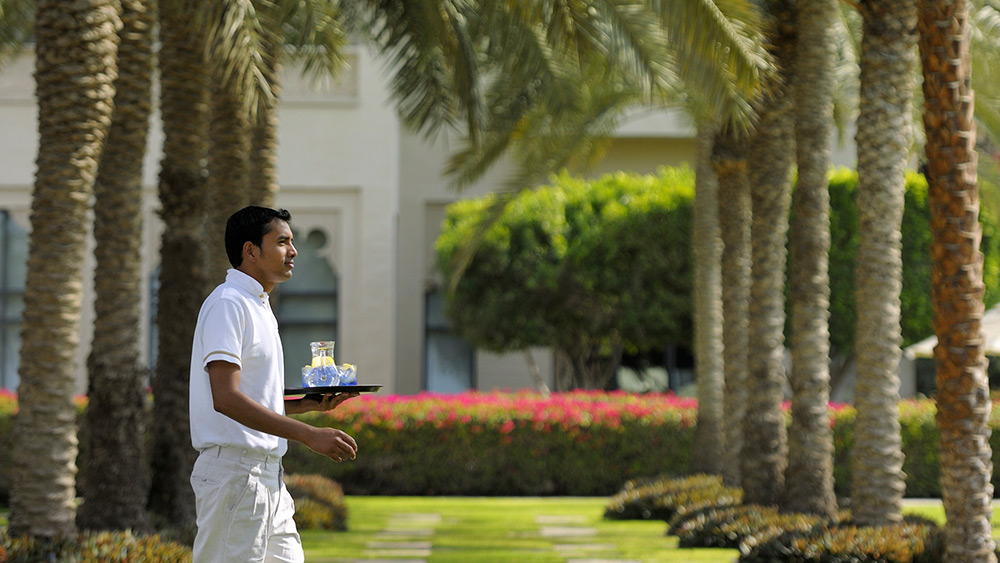 Waiter carrying drinks at Arabian Court at One&Only Royal Mirage