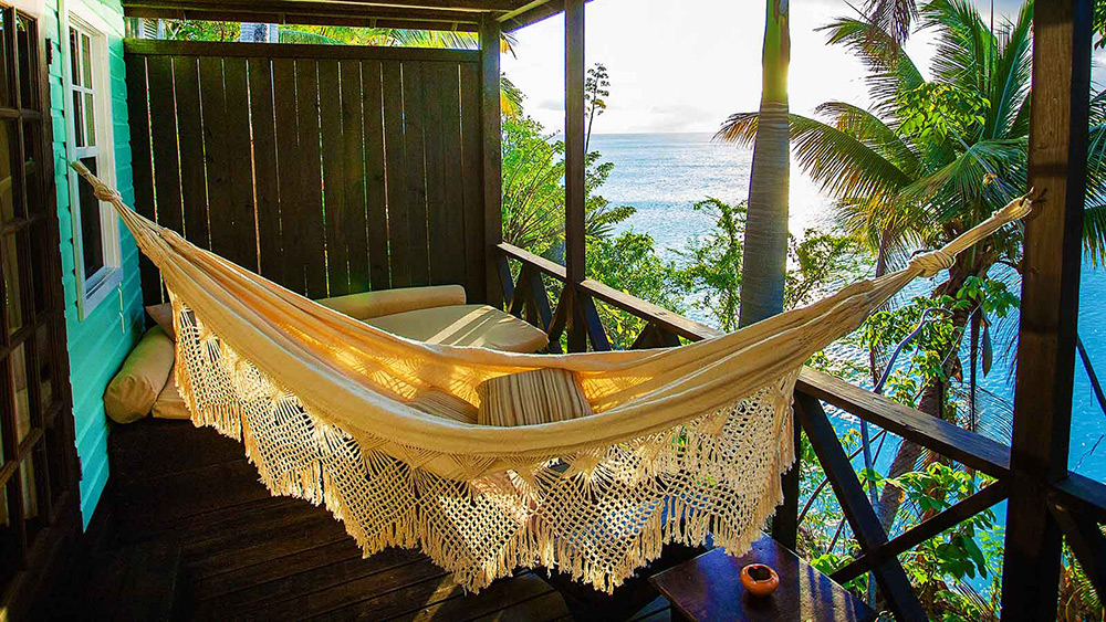 Hammock on the balcony of the Premium View Cottage at Cocos Hotel