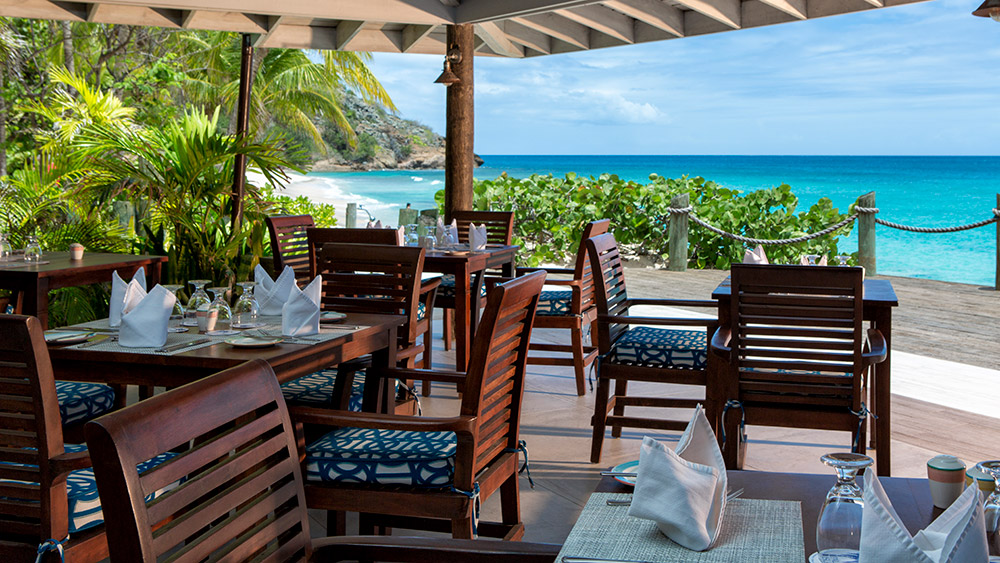 Outdoor dining terrace at Galley Bay Resort & Spa