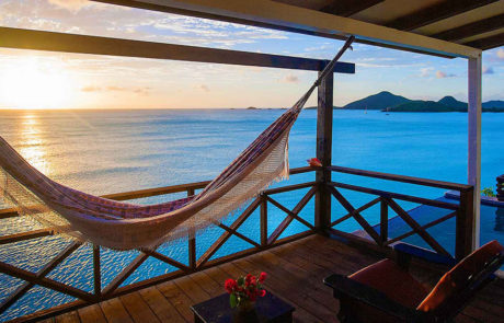 Hammock on a balcony at sunset at Cocos Hotel