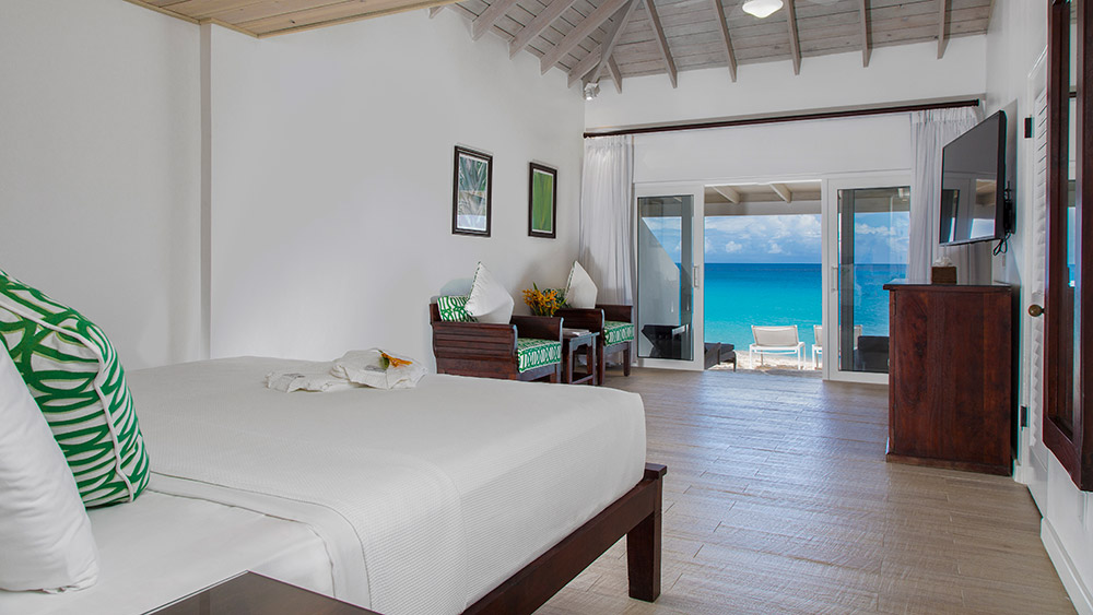 Bedroom of the Superior Deluxe Beachfront Room at Galley Bay Resort & Spa