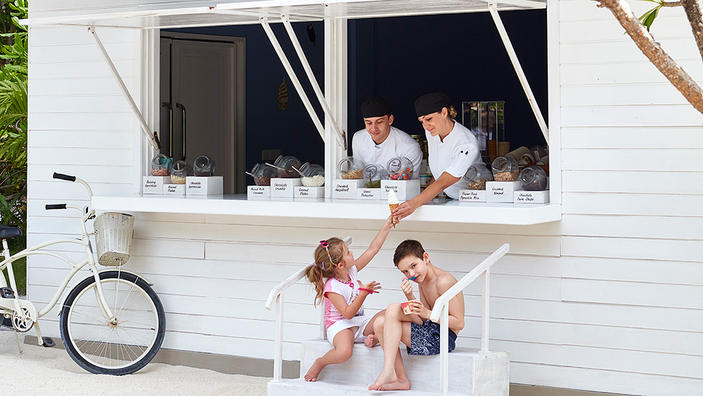 Kids being served ice cream at One&Only Reethi Rah