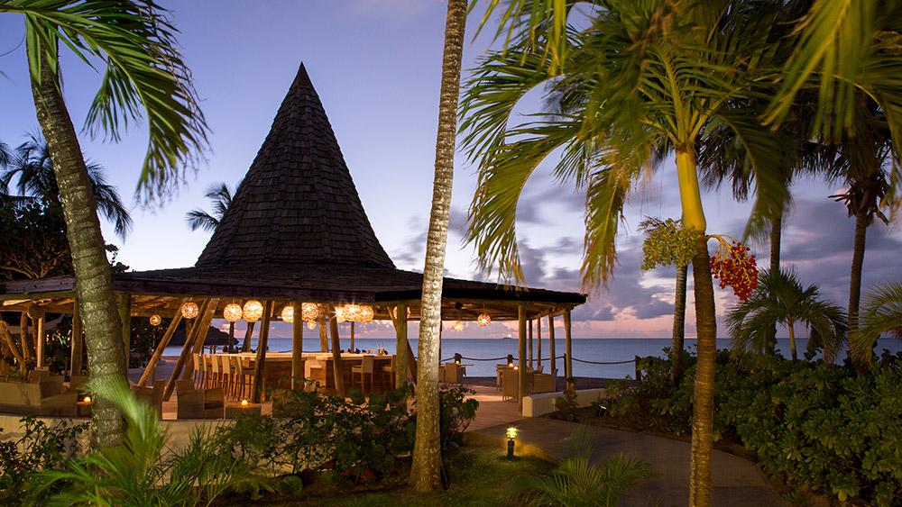 Outdoor bar at sunset at Galley Bay Resort & Spa