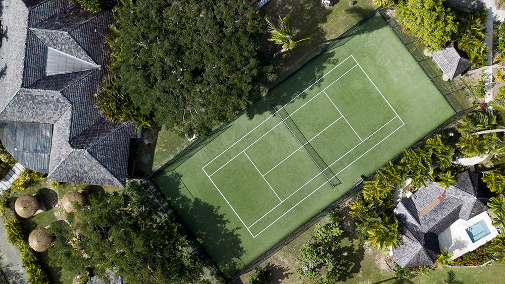 Aerial view of the tennis courts at Galley Bay Resort