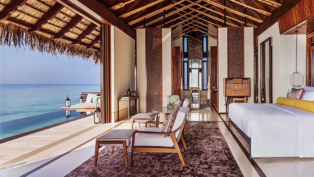 Bedroom view of the Water Villa with Pool at One&Only Reethi Rah
