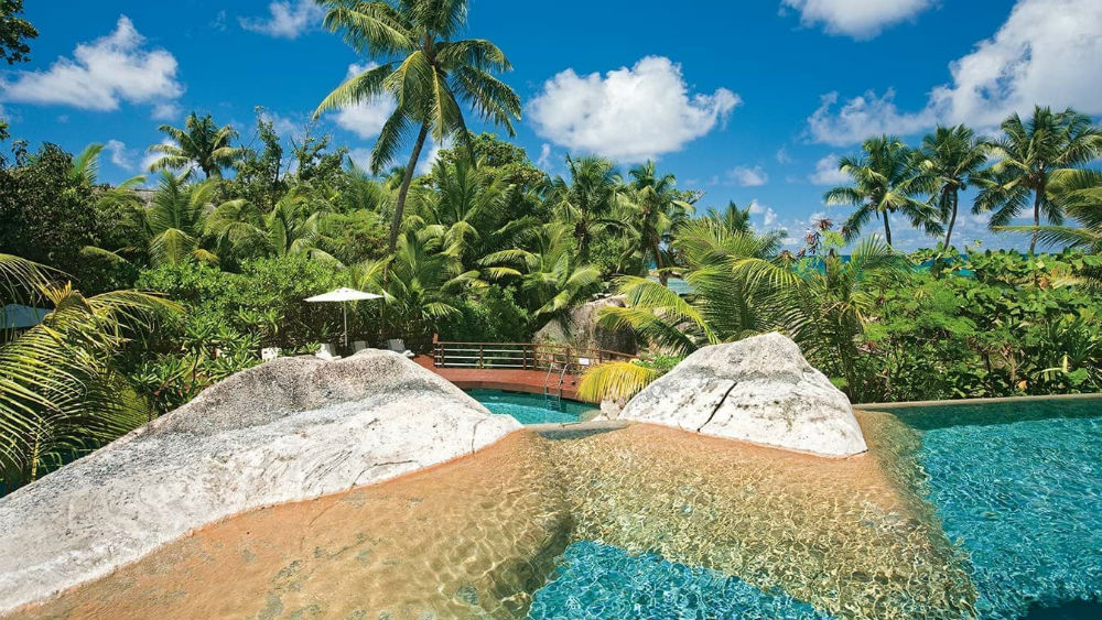 main pool with rock face at the Constance Lemuria Seychelles