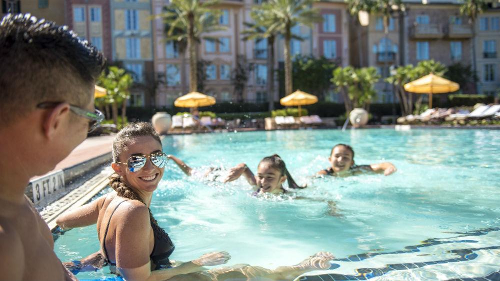 playing at the pool at the Loews Portofino Bay Hotel at Universal