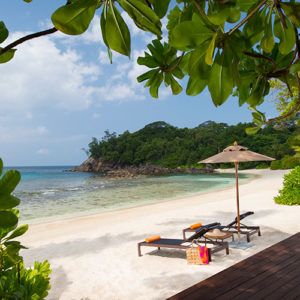 Sun loungers on the beach at AVANI Barbarons Seychelles