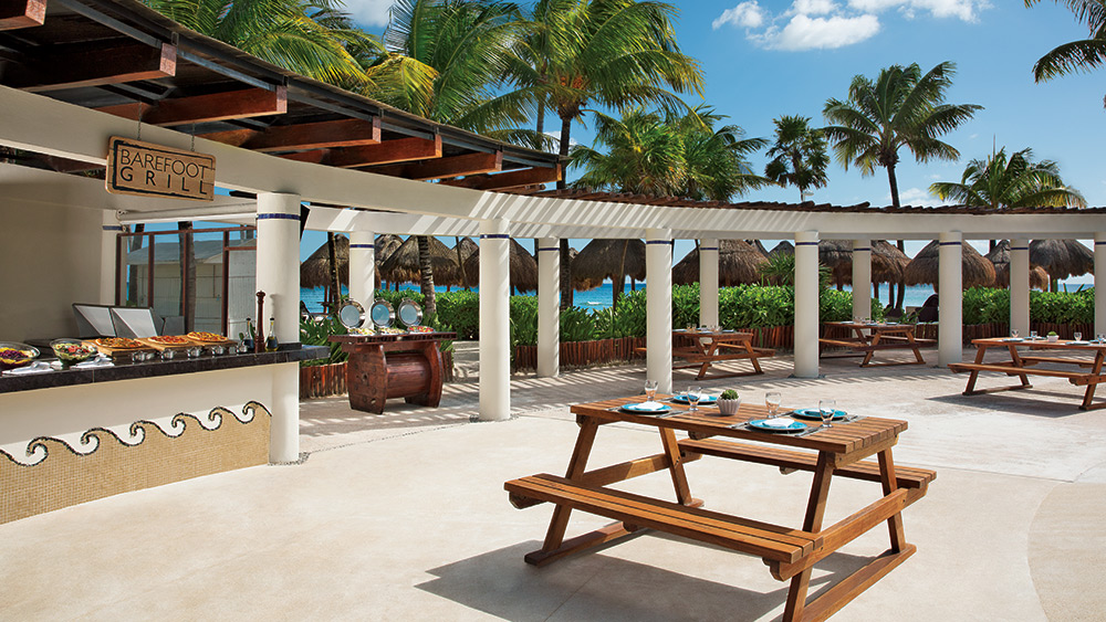 Outdoor dining at the beach at Dreams Tulum Resort & Spa