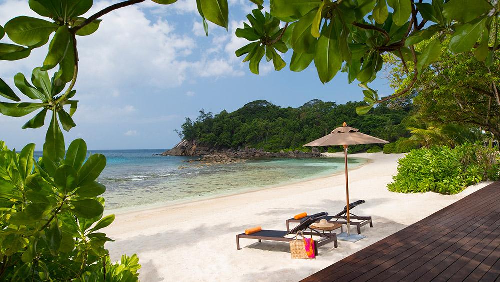 Sun loungers on the beach at AVANI Barbarons Seychelles