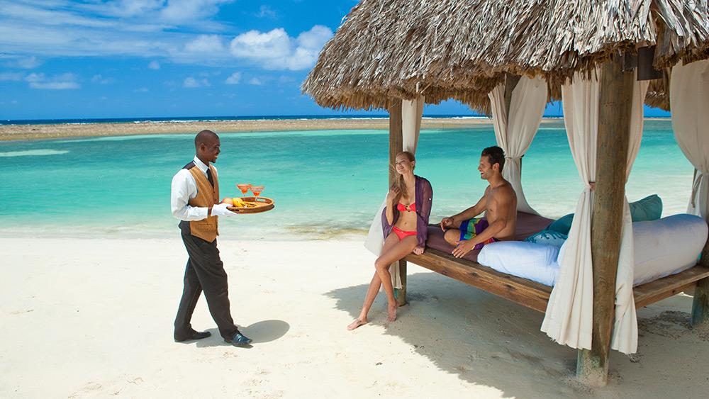 Butler service in a beach cabana at Sandals Royal Caribbean