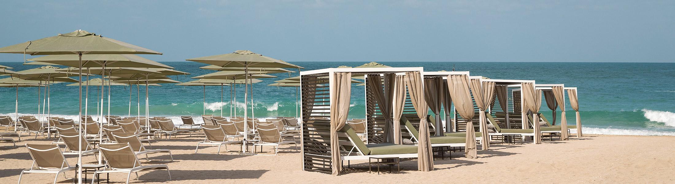 Beach Cabanas and sun loungers at Caesars Resort Bluewaters