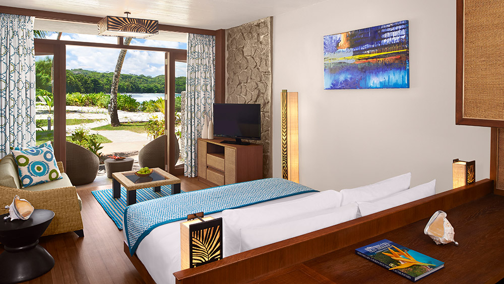 Bedroom with a view of the beach at AVANI Barbarons Seychelles