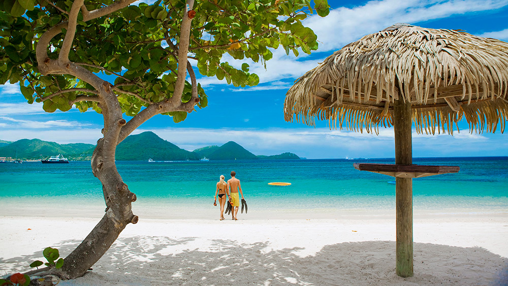 Couple on the beach at Sandals Grande St Lucian