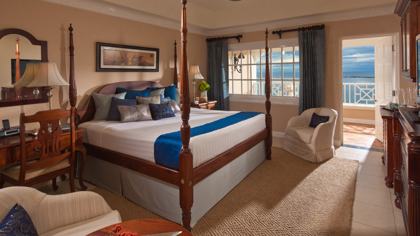 Bedroom of the Beachfront Grande Luxe Room at Sandals Royal Caribbean