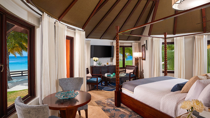 Bedroom of the Beachfront Grande Rondoval Suite with Pool at Sandals Grande St Lucian