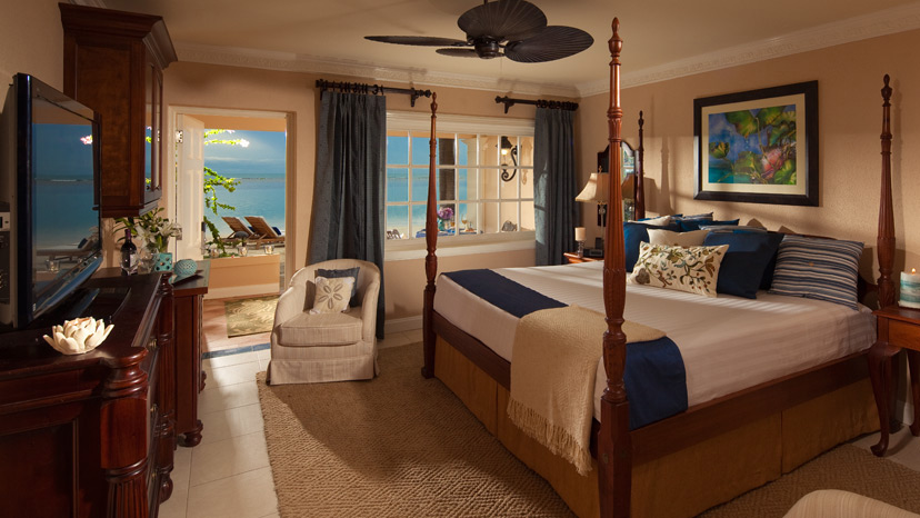 Bedroom of the Beachfront Honeymoon Walkout Club Level Room at Sandals Royal Caribbean