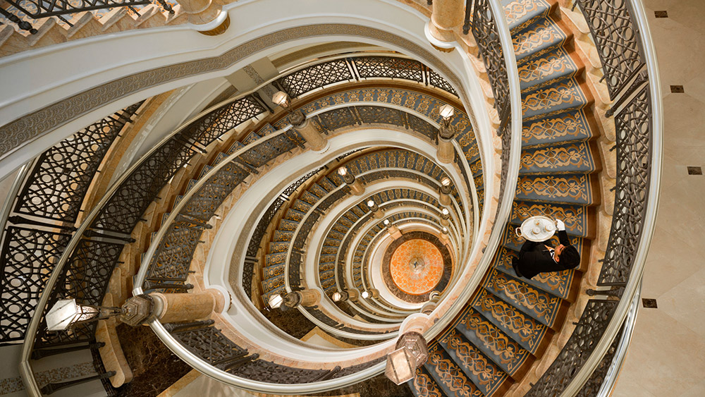 Spiral staircase with a butler at Emirates Palace