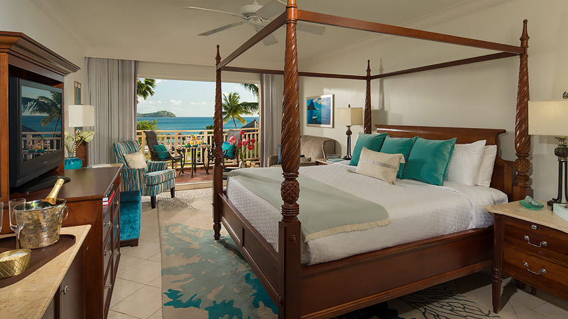 Bedroom of the Caribbean Beachview Club room at Sandals Grande St Lucian