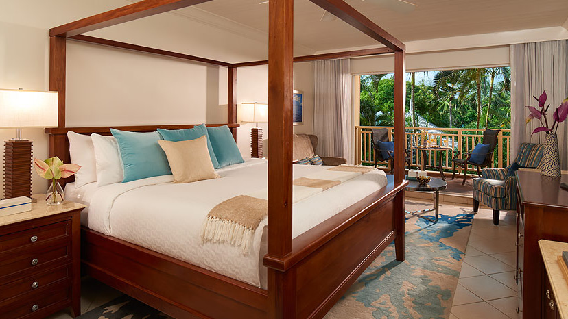 Bedroom of the Caribbean Deluxe room at Sandals Grande St Lucian