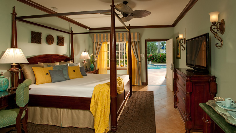 Bedroom of the Caribbean Grande Luxe Poolside Room at Sandals Royal Caribbean
