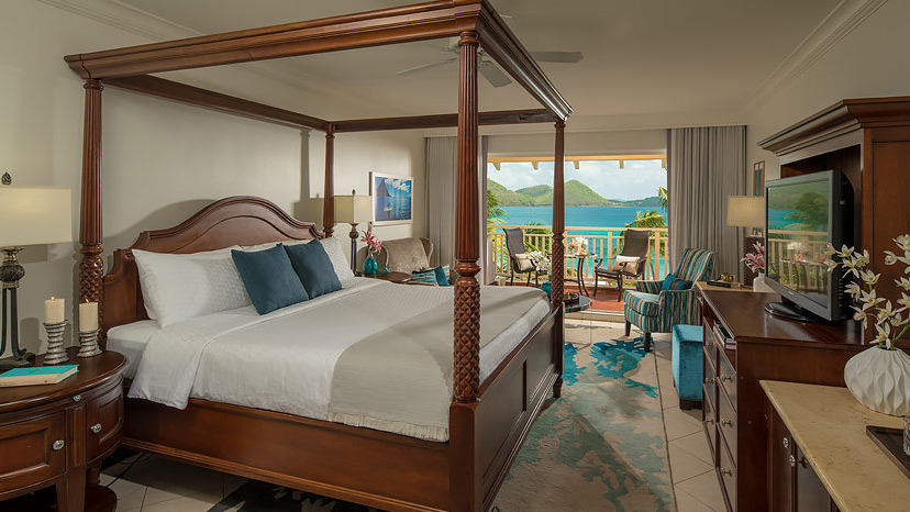 Bedroom of the Caribbean beachview Penthouse at Sandals Grande St Lucian