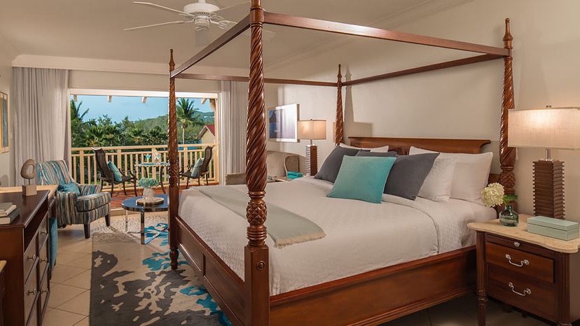 Bedroom of the Caribbean Club Level room at Sandals Grande St Lucian