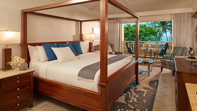 Bedroom of the Caribbean Luxury Oceanview room at Sandals Grande St Lucian