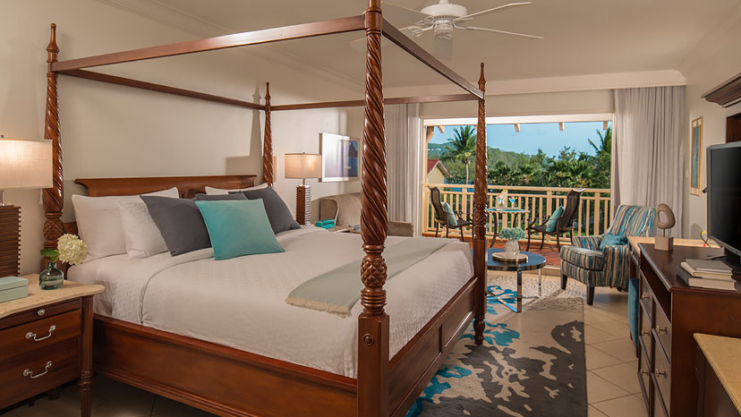 Bedroom of the Caribbean Tropical Premium room at Sandals Grande St Lucian