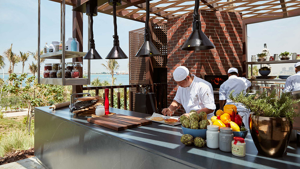 Chefs making pizza at Cleo's Table at Caesars Resort Bluewaters