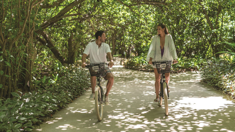 Couple Cycling Shangri La Villingili Maldives