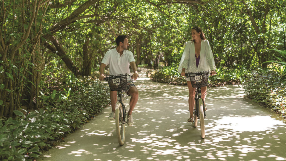 Couple Cycling the Island Shangri La Villingili Maldives