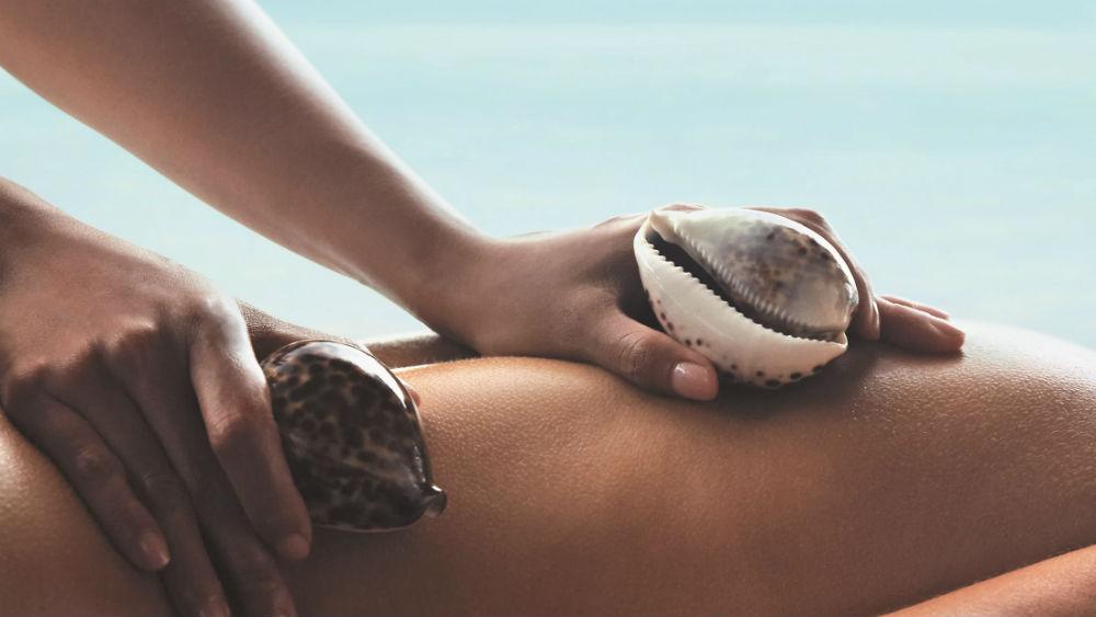 Cowrie shell massage Shangri La Villingili Maldives
