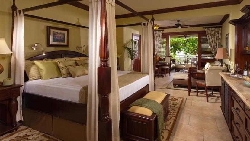 Bedroom of the Crystal Lagoon Honeymoon One Bedroom Suite at Sandals Royal Caribbean