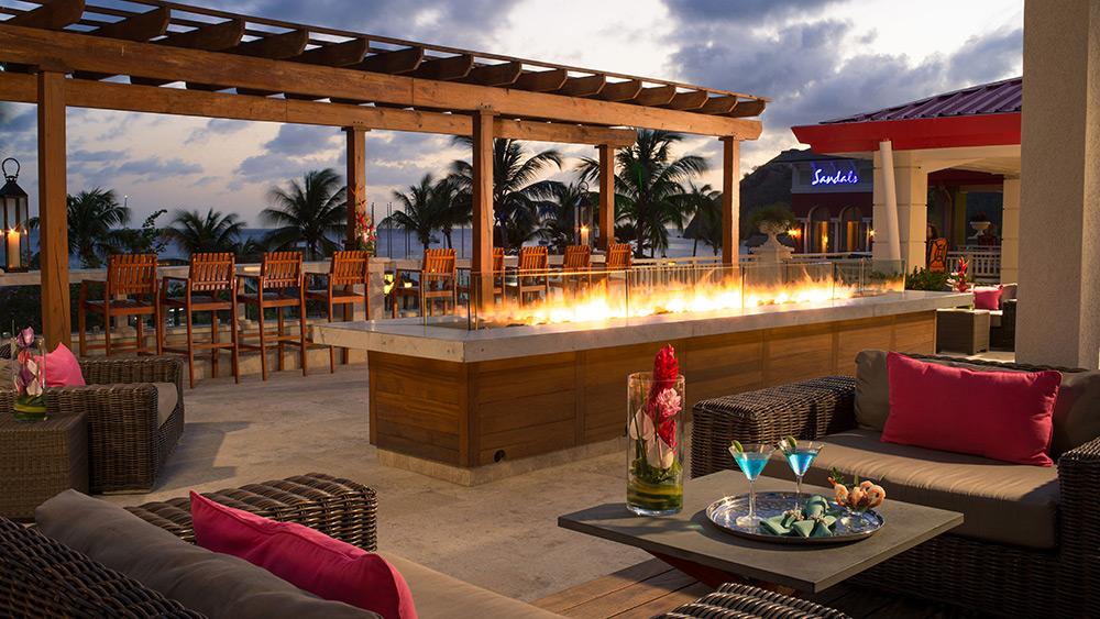 Fire pit at sunset at Sandals Grande St Lucian