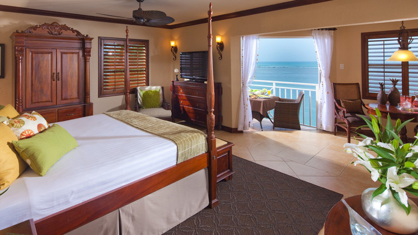 Bedroom of the Kensington Cove Honeymoon Beachfront Club Level Room at Sandals Royal Caribbean