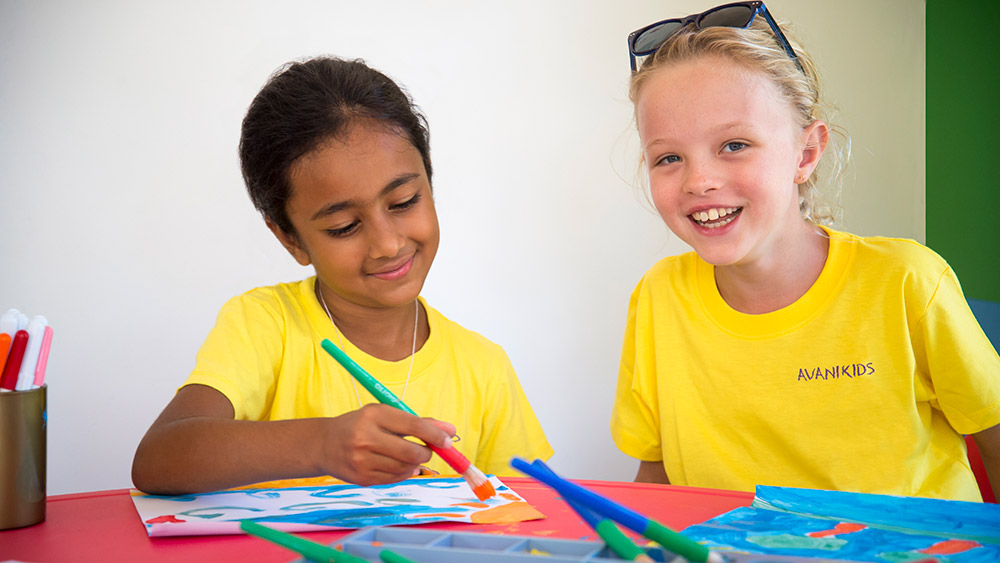 Children painting at the Kids Club at AVANI Barbarons Seychelles