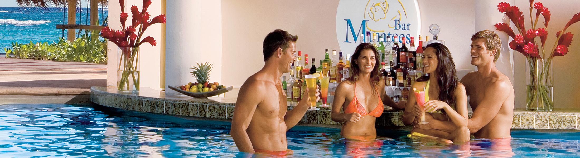 Friends at the swim up bar at Dreams Tulum Resort & Spa