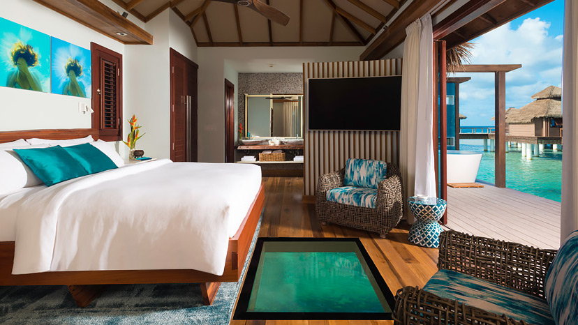 Bedroom of the Over-the-Water Private Island Honeymoon Bungalow at Sandals Royal Caribbean