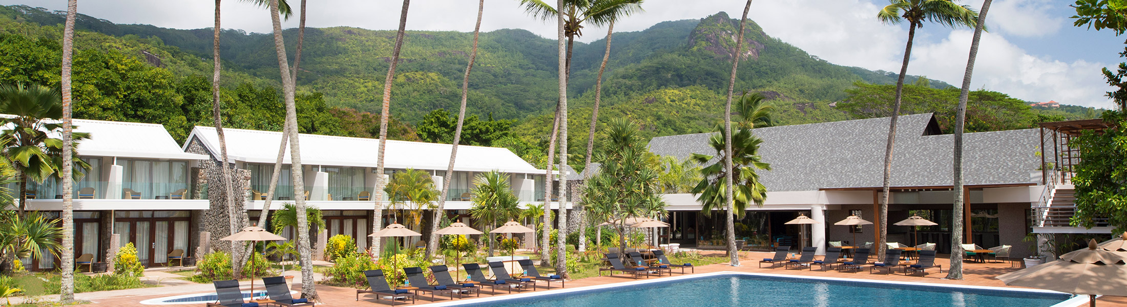 View of the resort pool and exterior at AVANI Barbarons Seychelles