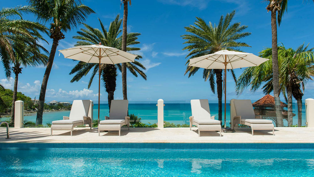 Pool and loungers at the Blue Waters Antigua