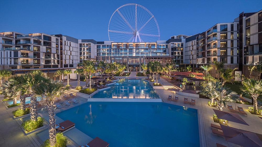 The main pool and the Dubai Wheel at Caesars Palace Bluewaters