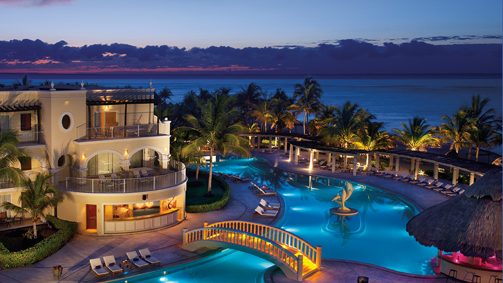Main pool at night at Dreams Tulum Resort & Spa