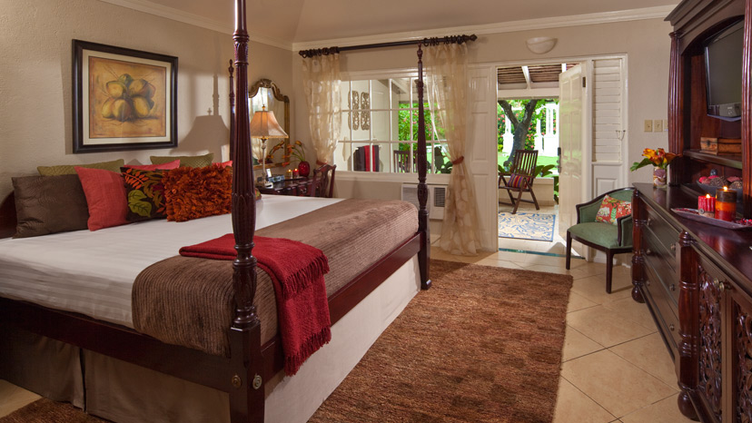 Bedroom of the Royal Sanctuary Grande Luxe Room at Sandals Royal Caribbean