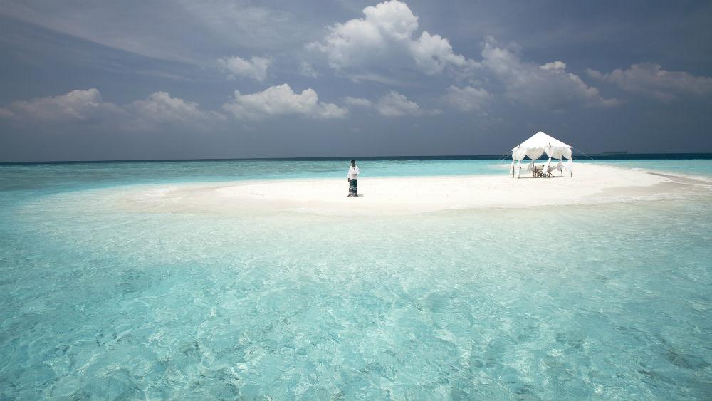Sandbank Waiter at the Baros Maldives
