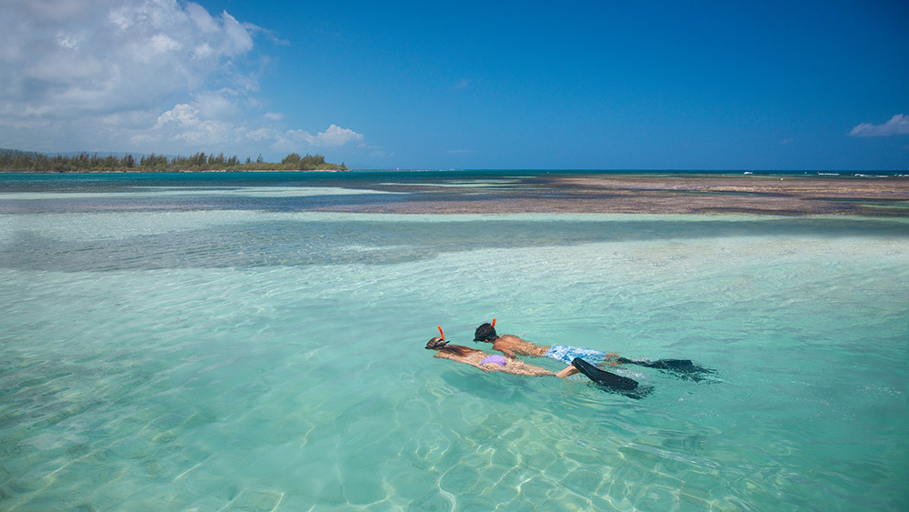 Couple snorkelling at Sandals Royal Caribbean